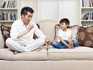 shutterstock parent having serious conversation with child