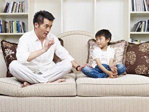 shutterstock parent having serious conversation with child
